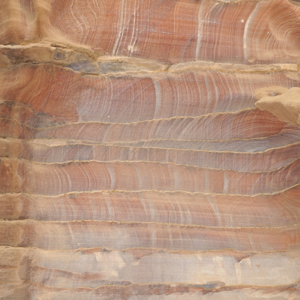 The sandstone from which is carved the many colossal monuments at Petra