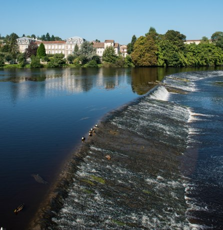 The top third of the frame provides a context for this image of the weir on the River Vienne in Confolens