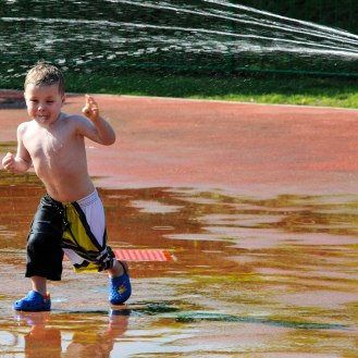 My grandson getting a soaking at a water-park in Abu Dhabi. Using the rule of thirds means we also get to see where the soaking is coming from.