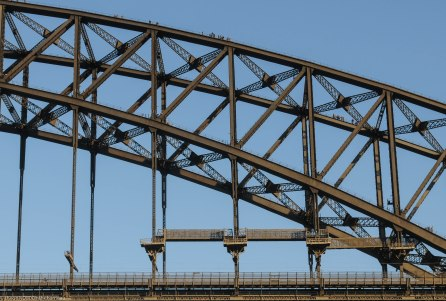 Detail of the steelwork of the Sydney Harbour Bridge (for an idea of scale, those are people on the top).